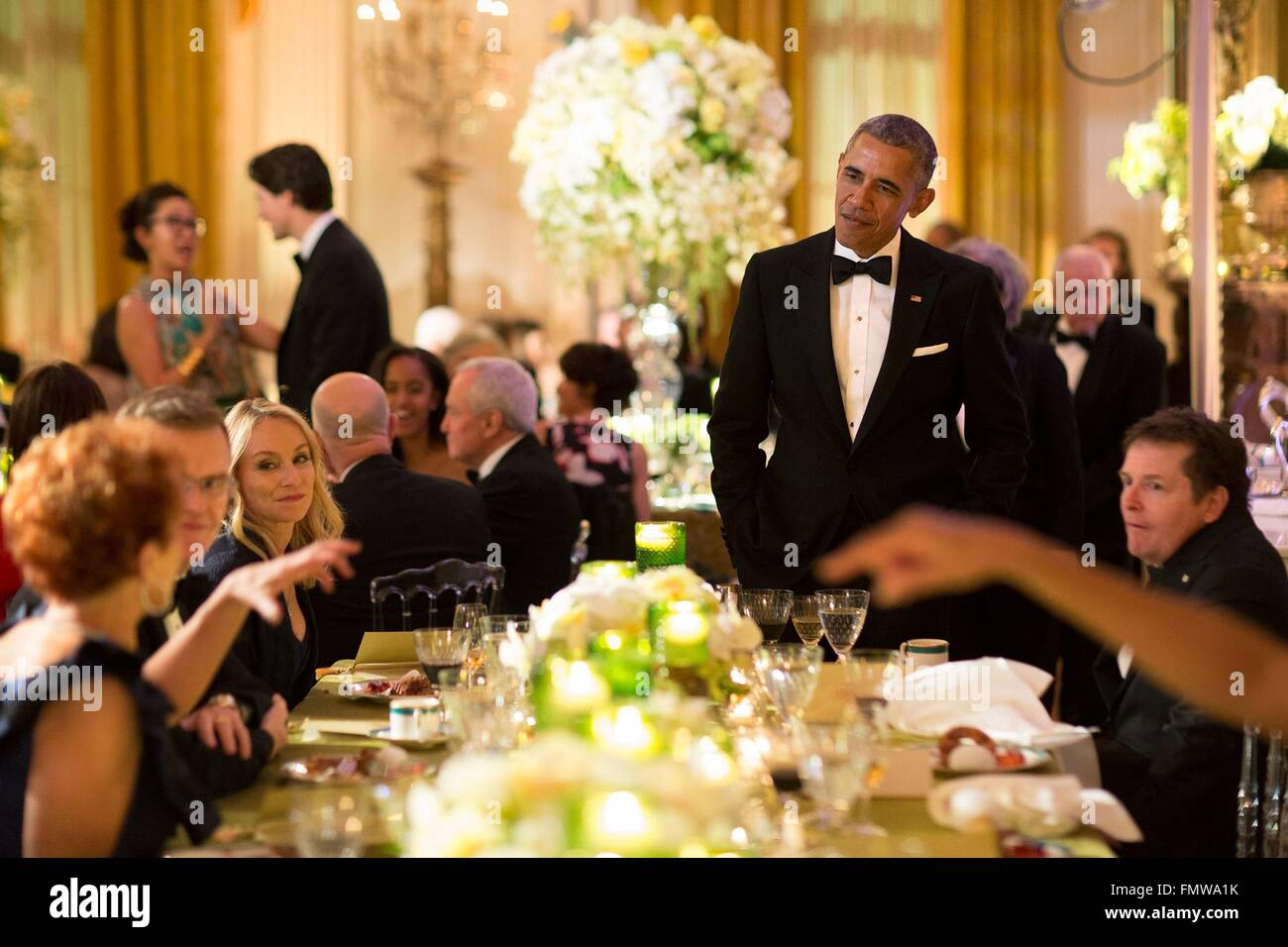 U.S. President Barack Obama speaks with dinner guests during the State Dinner for Canadian Prime Minister Justin - Stock Image