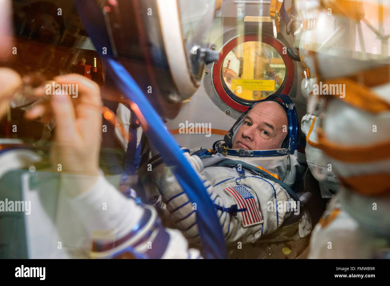 International Space Station Expedition 47 astronaut Jeff Williams of NASA inside the Soyuz TMA-20M spacecraft during Stock Photo