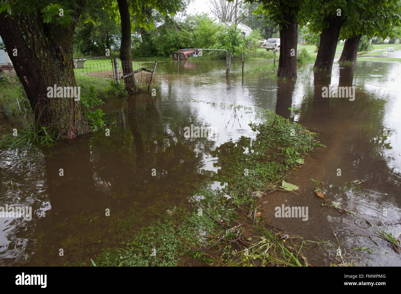 Heavy rains from Tropical storm Bill flooded the yard of houses outside the city of Tulsa, Oklahoma in June 2015. - Stock Image