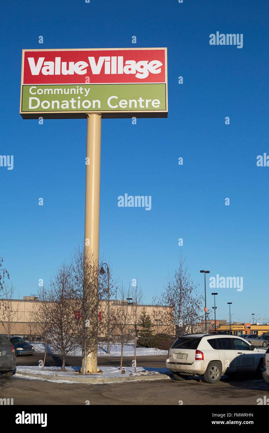 Value Village Community Donation Centre in suburban shopping mall - Stock Image