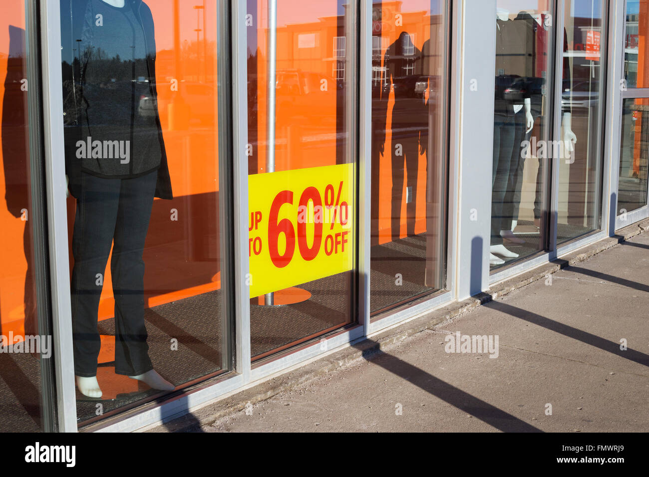 Sale sign in store window of suburban shopping centre - Stock Image