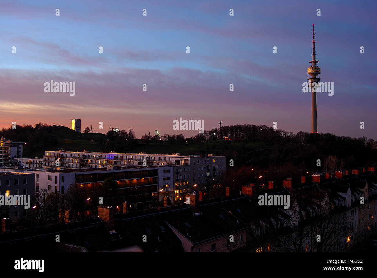 Olympic tower and appartment buildings in Munich seen at sunset - Stock Image