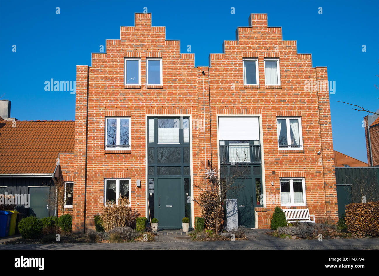 New duplex houses made with red bricks seen in Germany - Stock Image