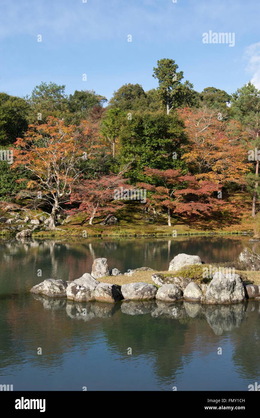 Japan, Kinki Region, Kyoto Prefecture, Kyoto City, Tenryu-ji Temple, Reflection of autumn trees on sogen pond. - Stock Image
