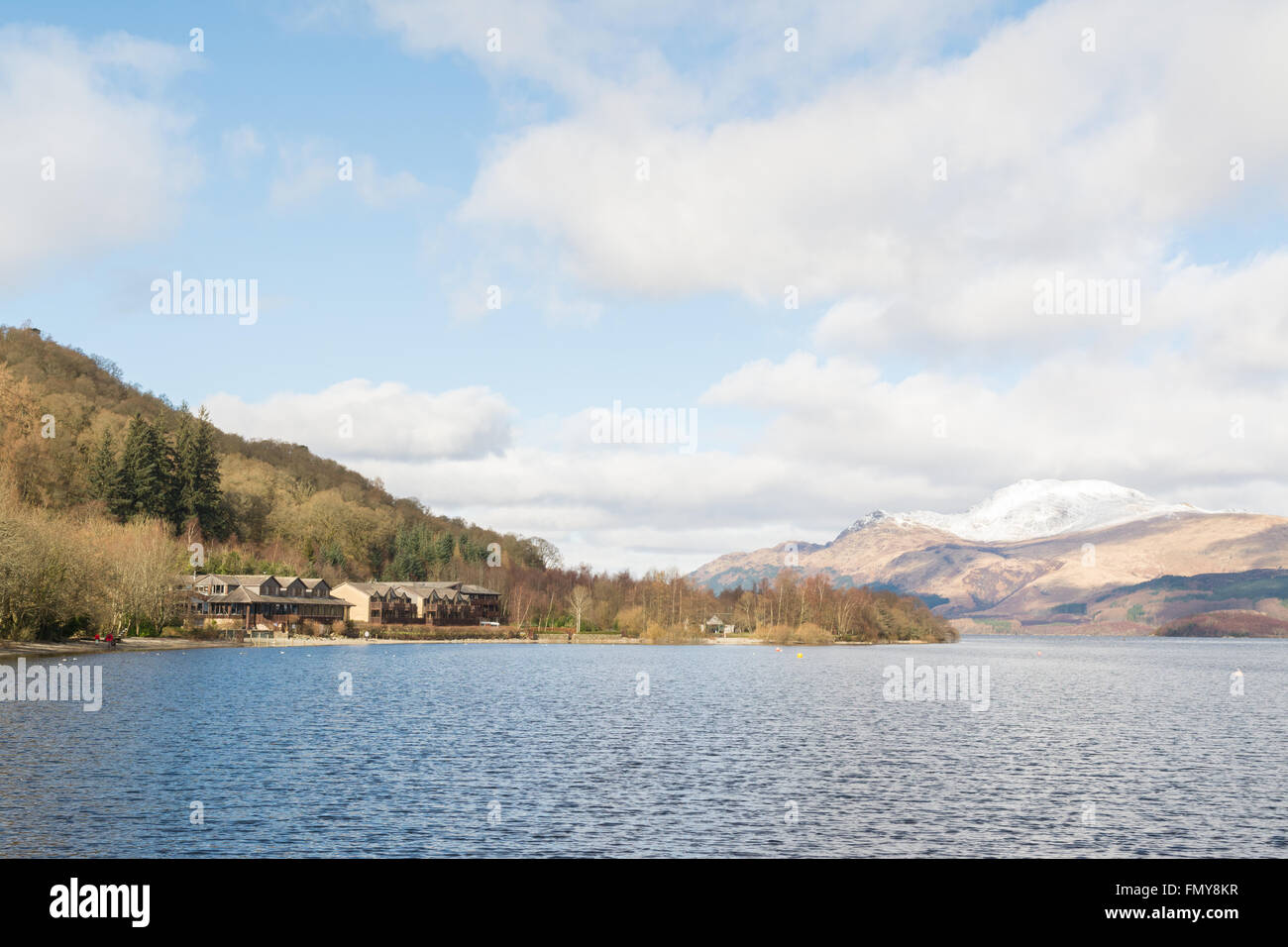 Lodge on Loch Lomond Hotel, Luss, Loch Lomond, Scotland in March with a snow capped Ben Lomond - Stock Image