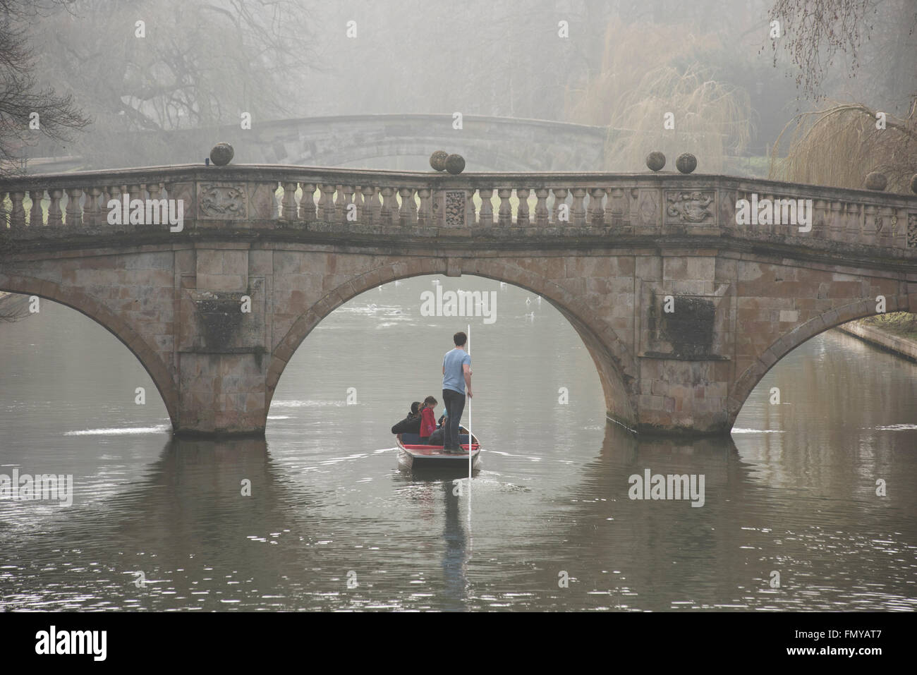 Cambridge, UK. 13th March, 2016. UK Weather: Cambridge misty River Cam and visitors punting. 13 March 2016 Punting - Stock Image