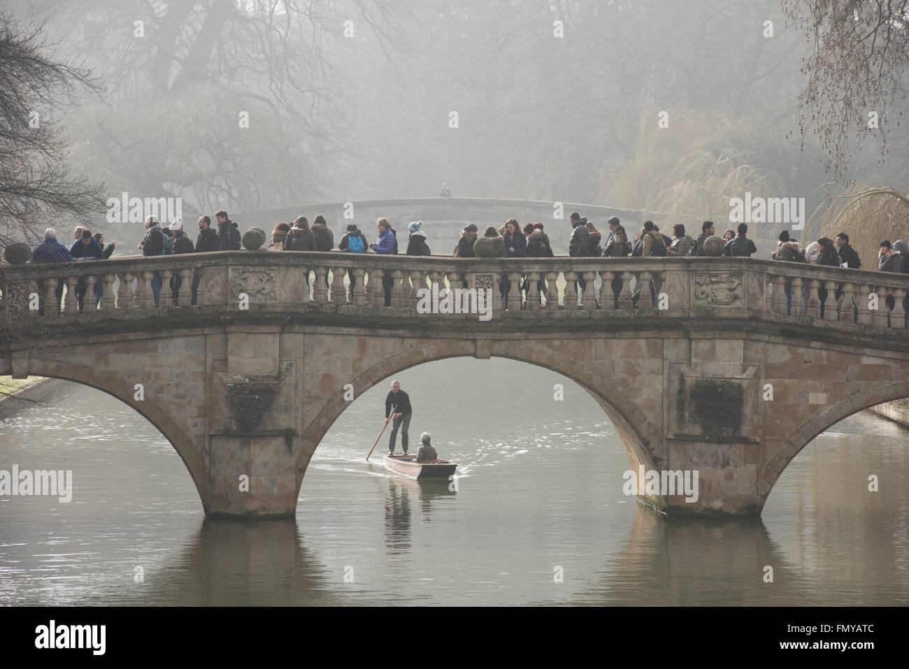 Cambridge, UK. 13th March, 2016. UK Weather: Cambridge misty River Cam and visitors punting. 13 March 2016 Student - Stock Image