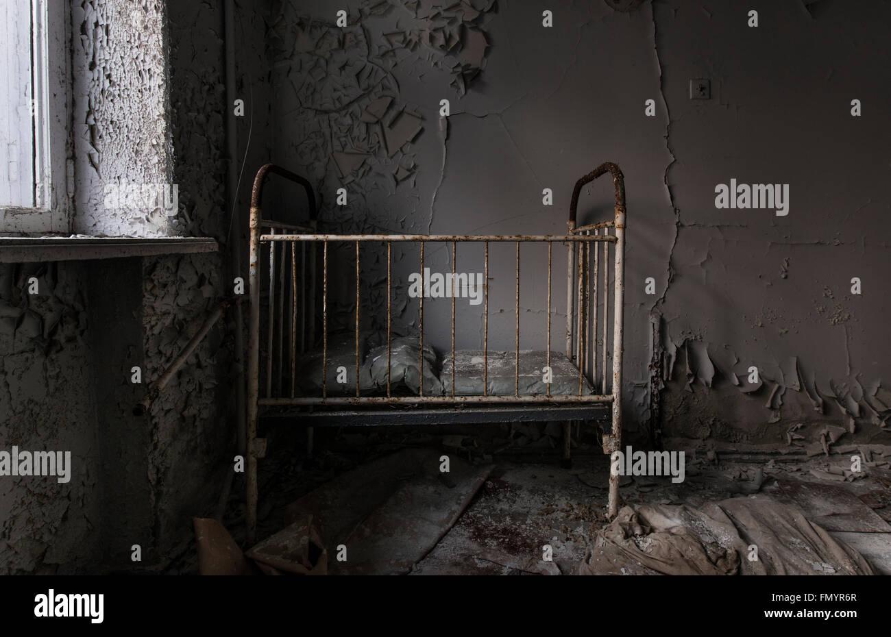 cot in Pripyat, Chernobyl scene of 1986 nuclear disaster - Stock Image