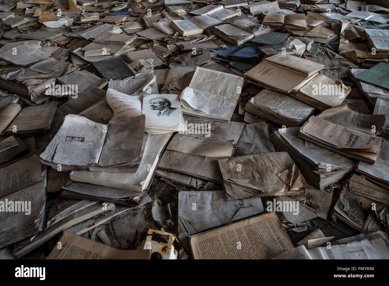 Books scattered across floor in Pripyat, Chernobyl scene of 1986 nuclear disaster - Stock Image