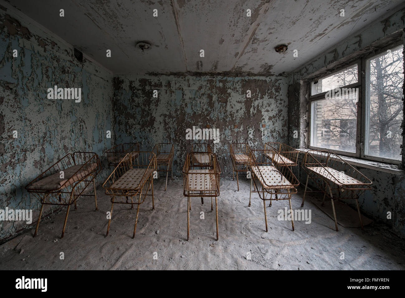 Babies cots in hospital in Pripyat, Chernobyl scene of 1986 nuclear disaster - Stock Image