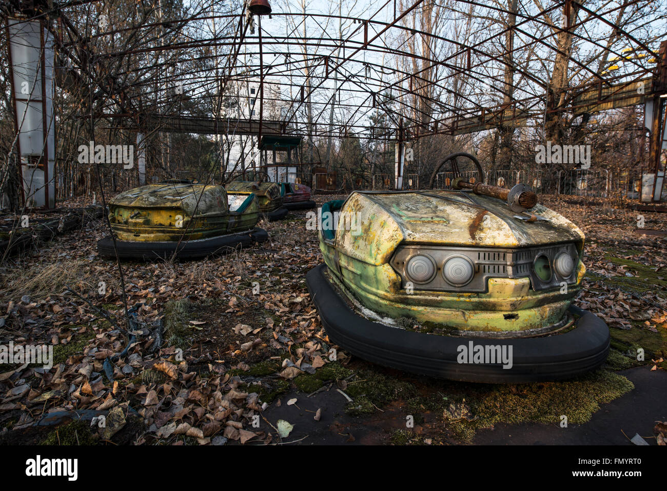 Abandoned dodgem cars in amusement park of Pripyat, Chernobyl scene of 1986 nuclear disaster - Stock Image