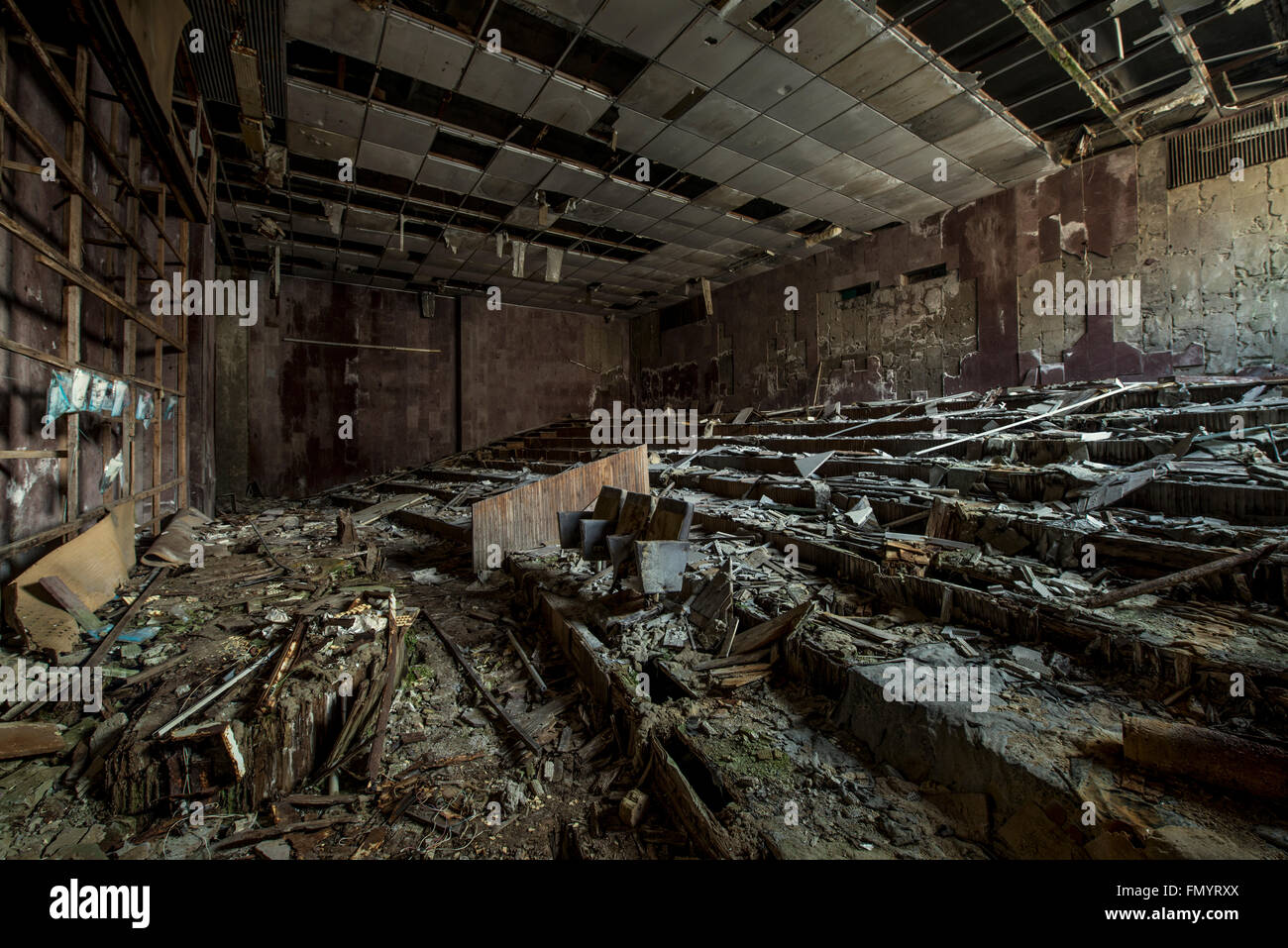 Burnt out cinema theater room in Pripyat, Chernobyl scene of 1986 nuclear disaster - Stock Image