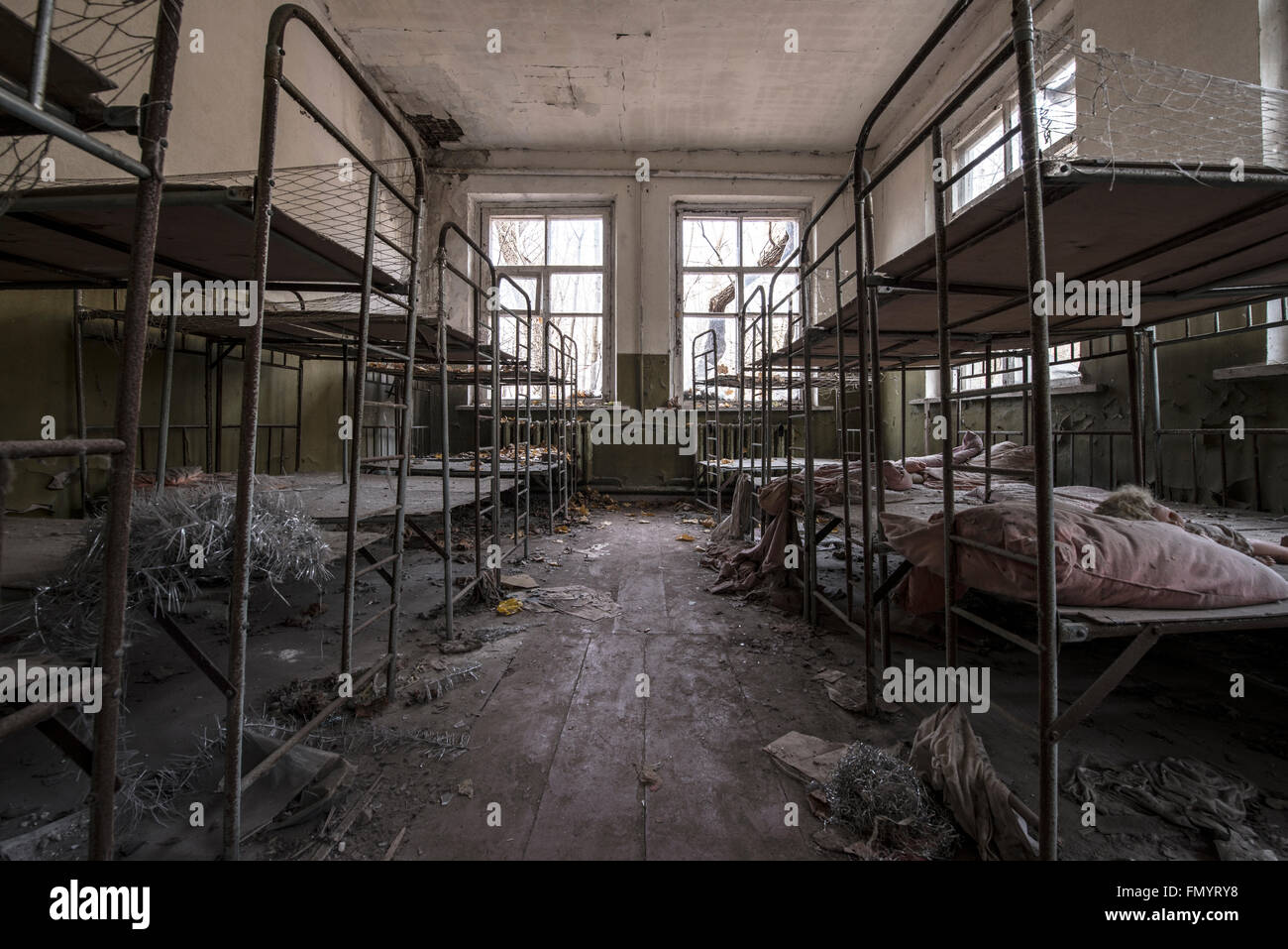 Children's bunk beds in Kindergarten in Pripyat, Chernobyl scene of 1986 nuclear disaster - Stock Image
