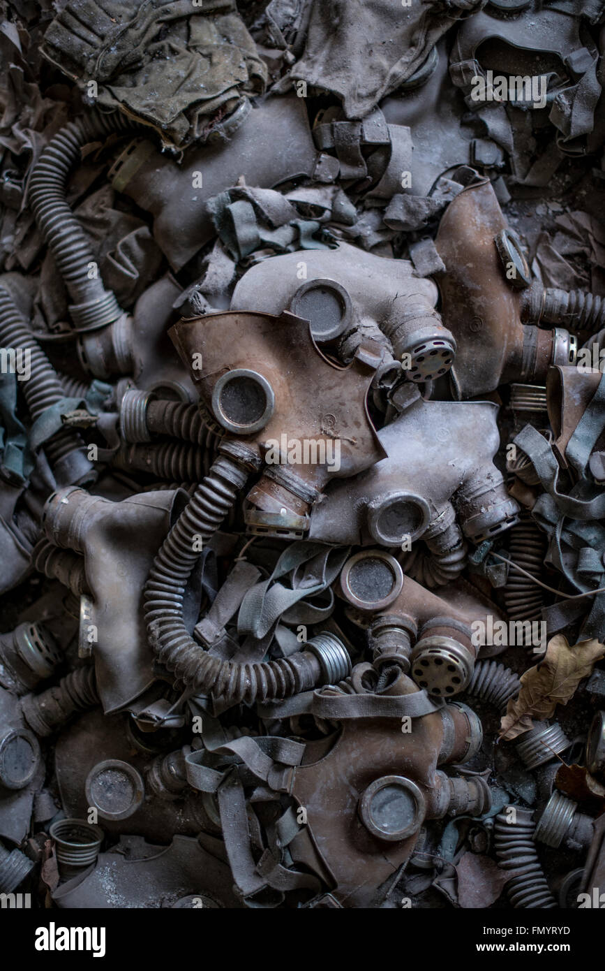 Children's gas masks strewn over classroom floor of elementary school in Pripyat, Chernobyl scene of 1986 nuclear - Stock Image