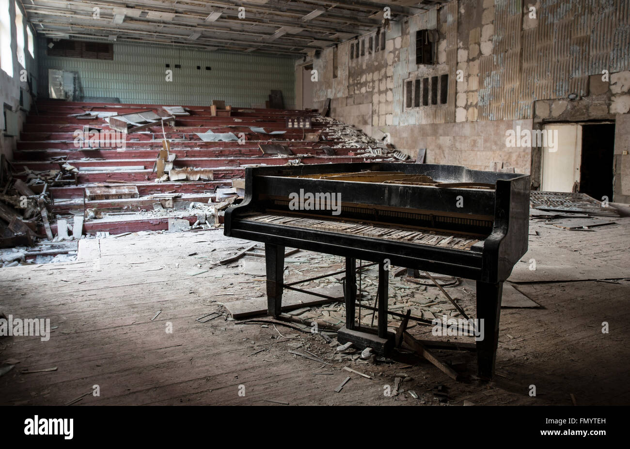 Lone piano in music hall of  Pripyat, Chernobyl scene of 1986 nuclear disaster - Stock Image