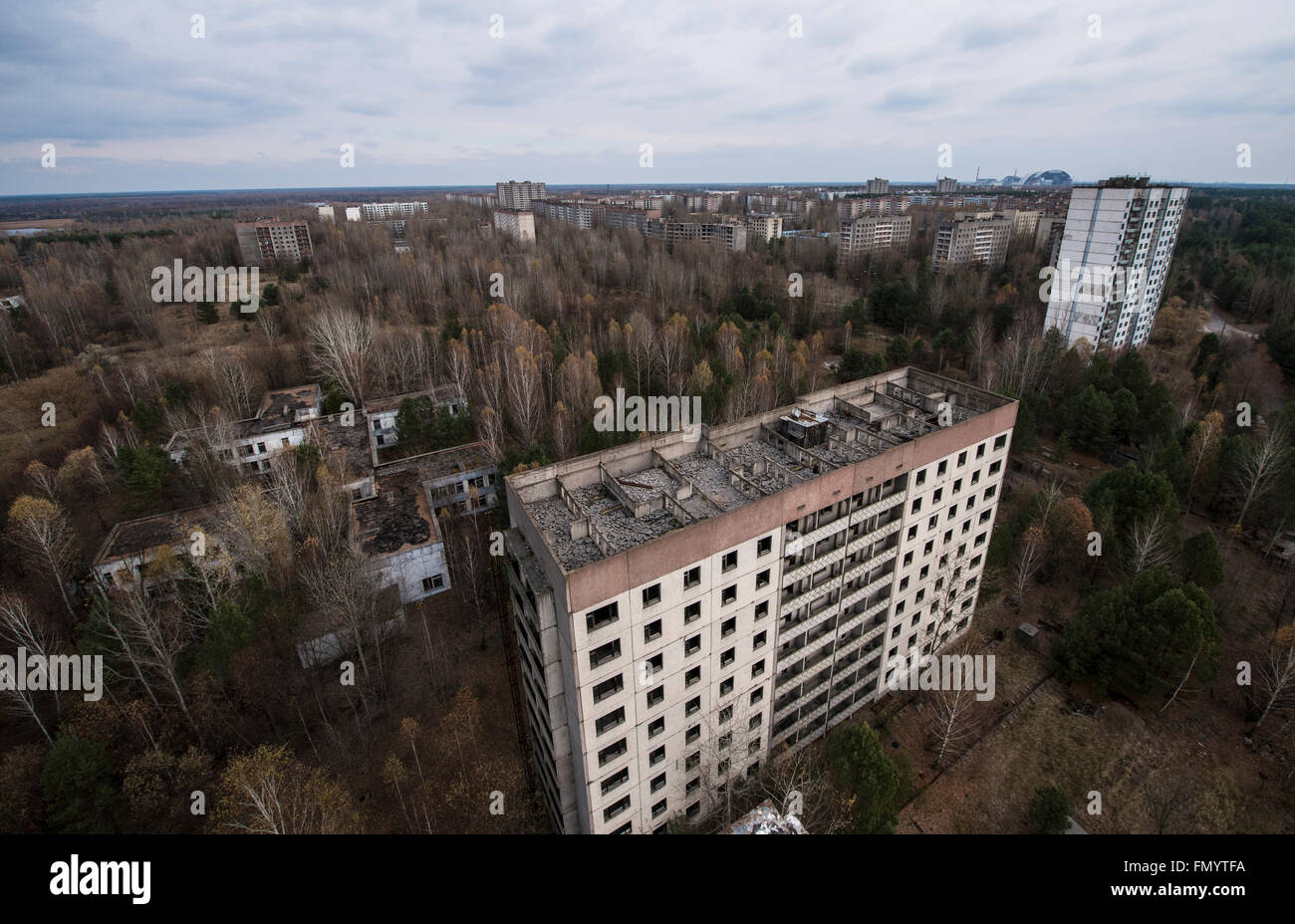 Aerial vue of Pripyat with the ill fated reactor in the background, Chernobyl scene of 1986 nuclear disaster - Stock Image