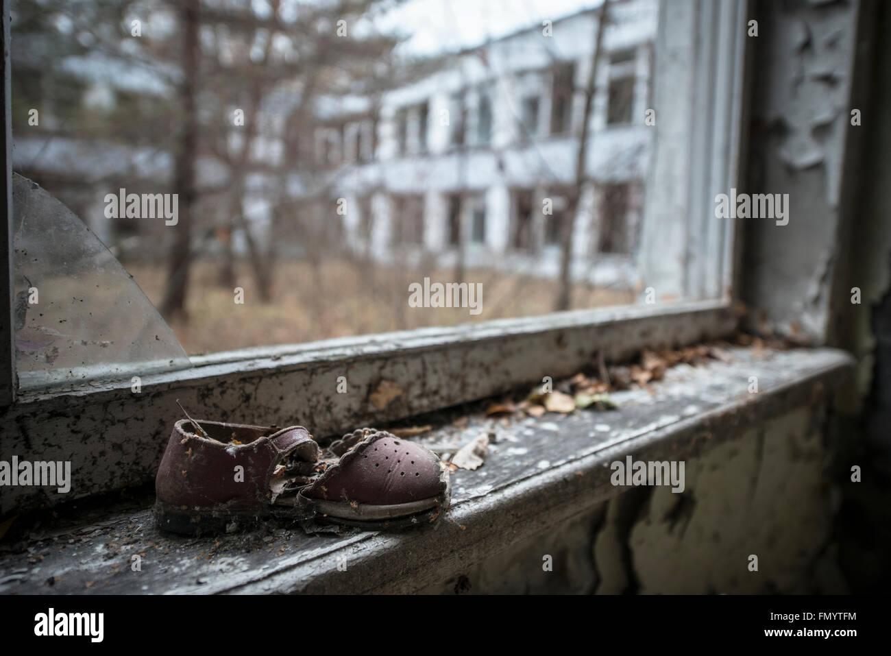 Child's shoe in kidergarten  in Pripyat, Chernobyl scene of 1986 nuclear disaster - Stock Image