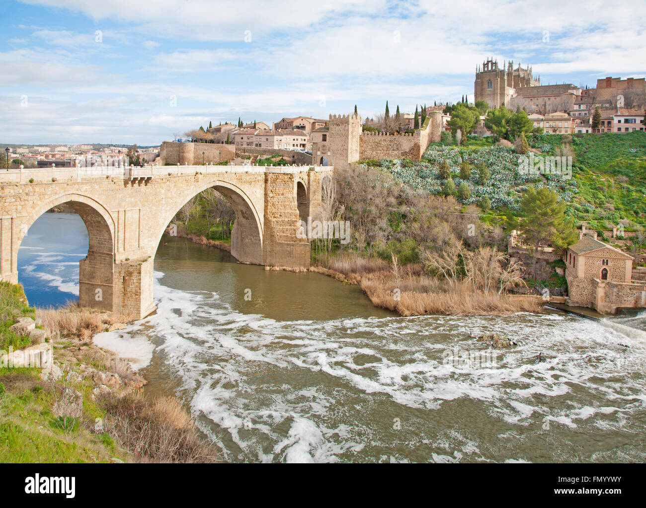 Toledo - Look to San Martin s bride or Puente de san Martin to Monastery of saint John of the King in morning light - Stock Image