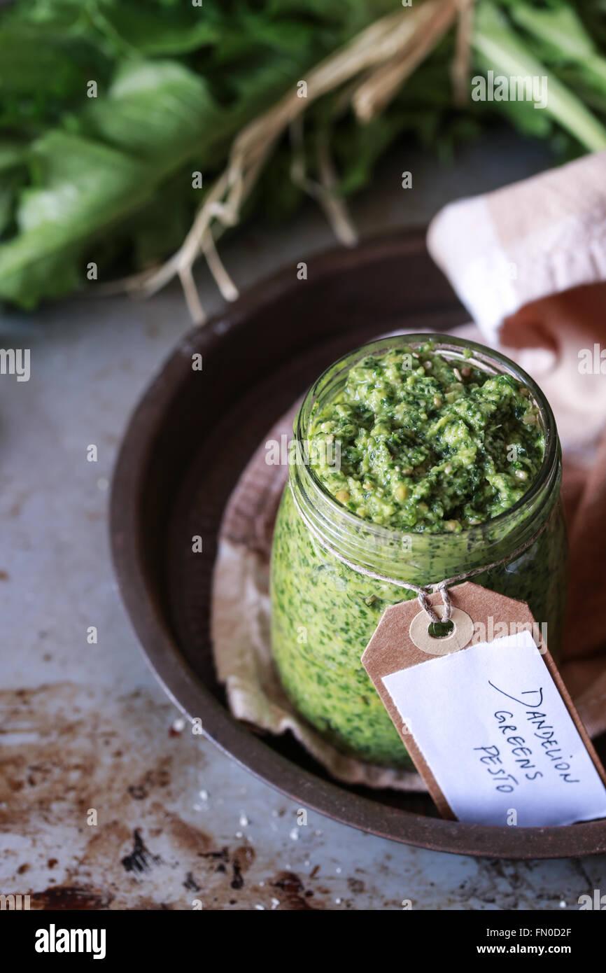 Homemade dandelion greens pesto Stock Photo