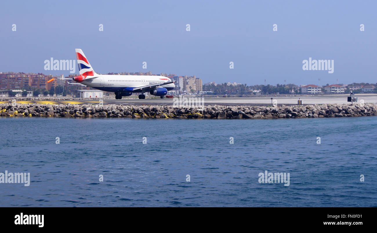 GIBRALTAR, ENGLAND - APRIL 13, 2014: The Airport of Gibraltar with the aeroplane. - Stock Image