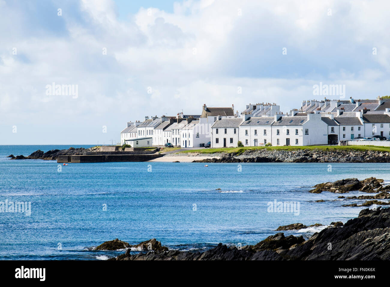 View across bay in Loch Indaal to Scottish village of Port Charlotte on Isle of Islay Inner Hebrides Argyll & - Stock Image