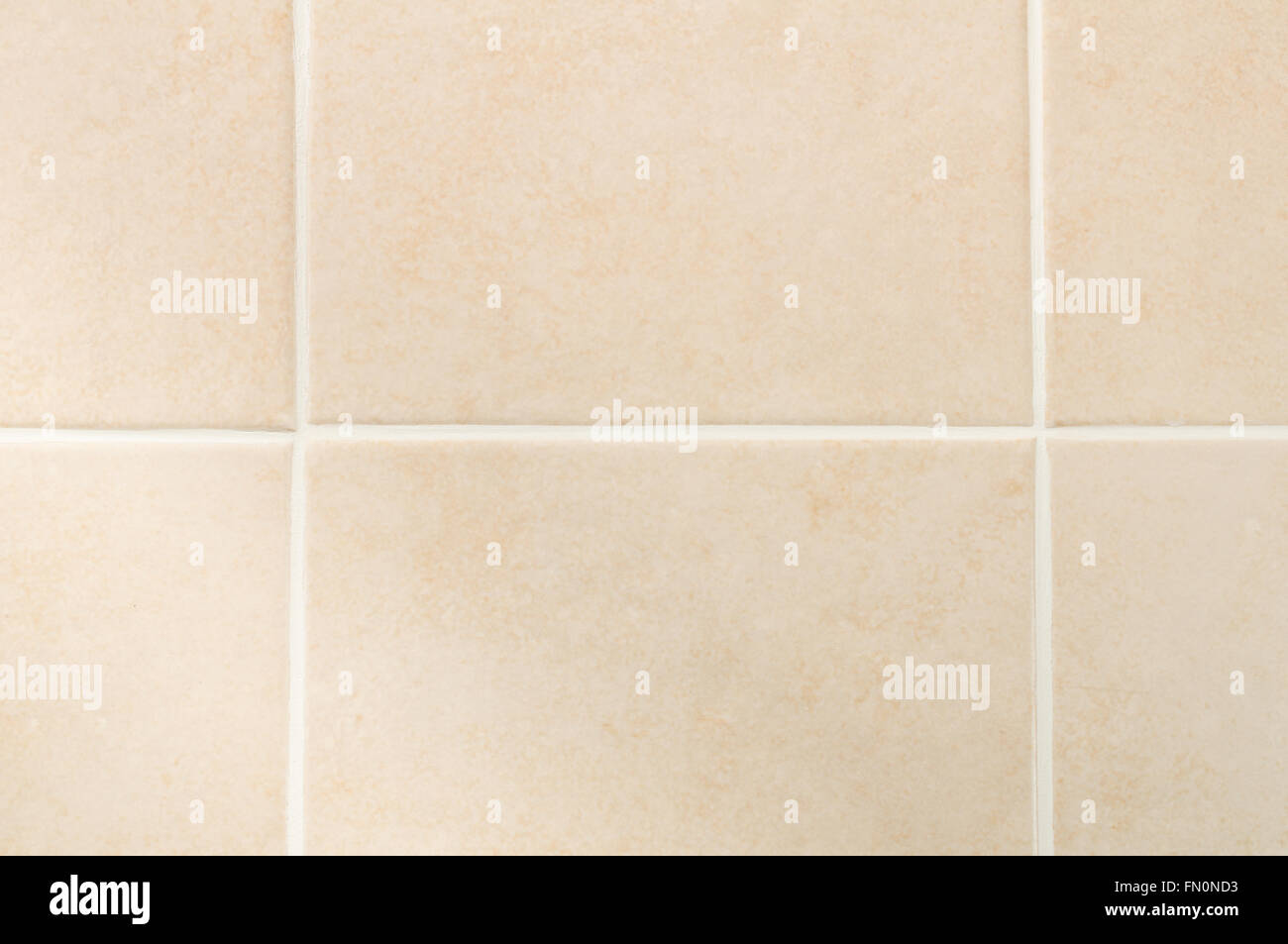 Cream tile wall with white grout pattern, front view Stock Photo ...