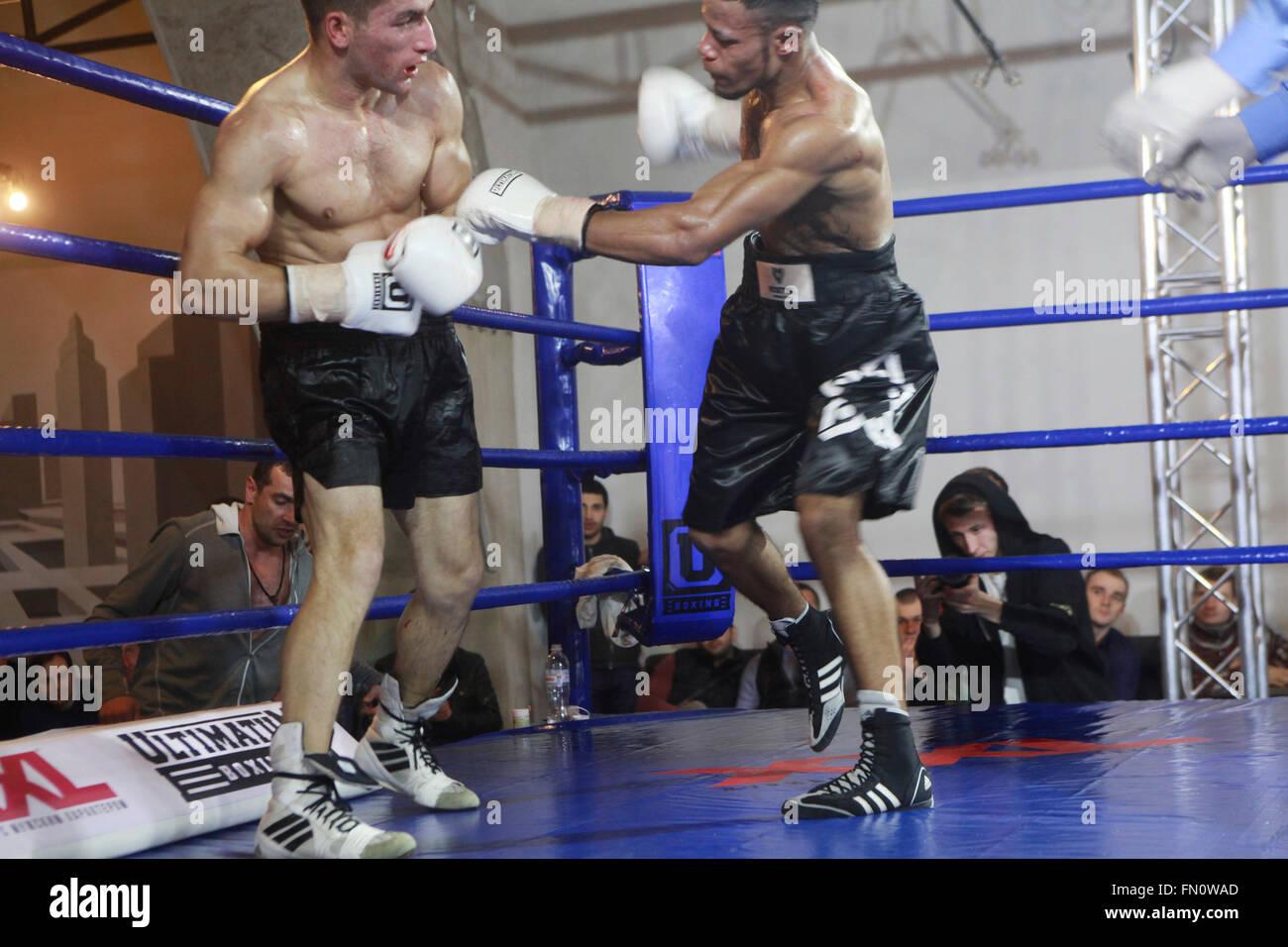 Kiev, Ukraine. 12th March, 2016. Afro-Ukrainian 19 years old welterweight Vlad Baranov attacks Georgian Nikoloz Stock Photo