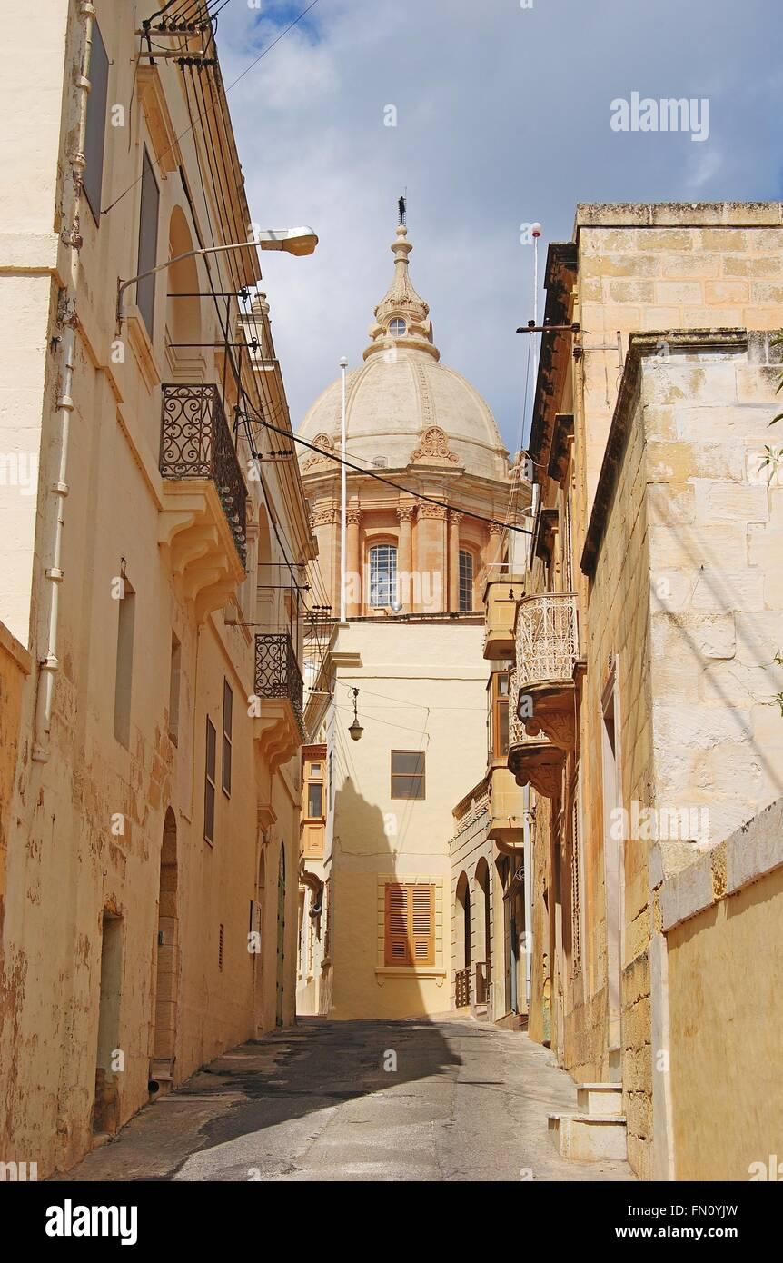 Street view with basilica in Nadur village on Gozo island, Malta. - Stock Image