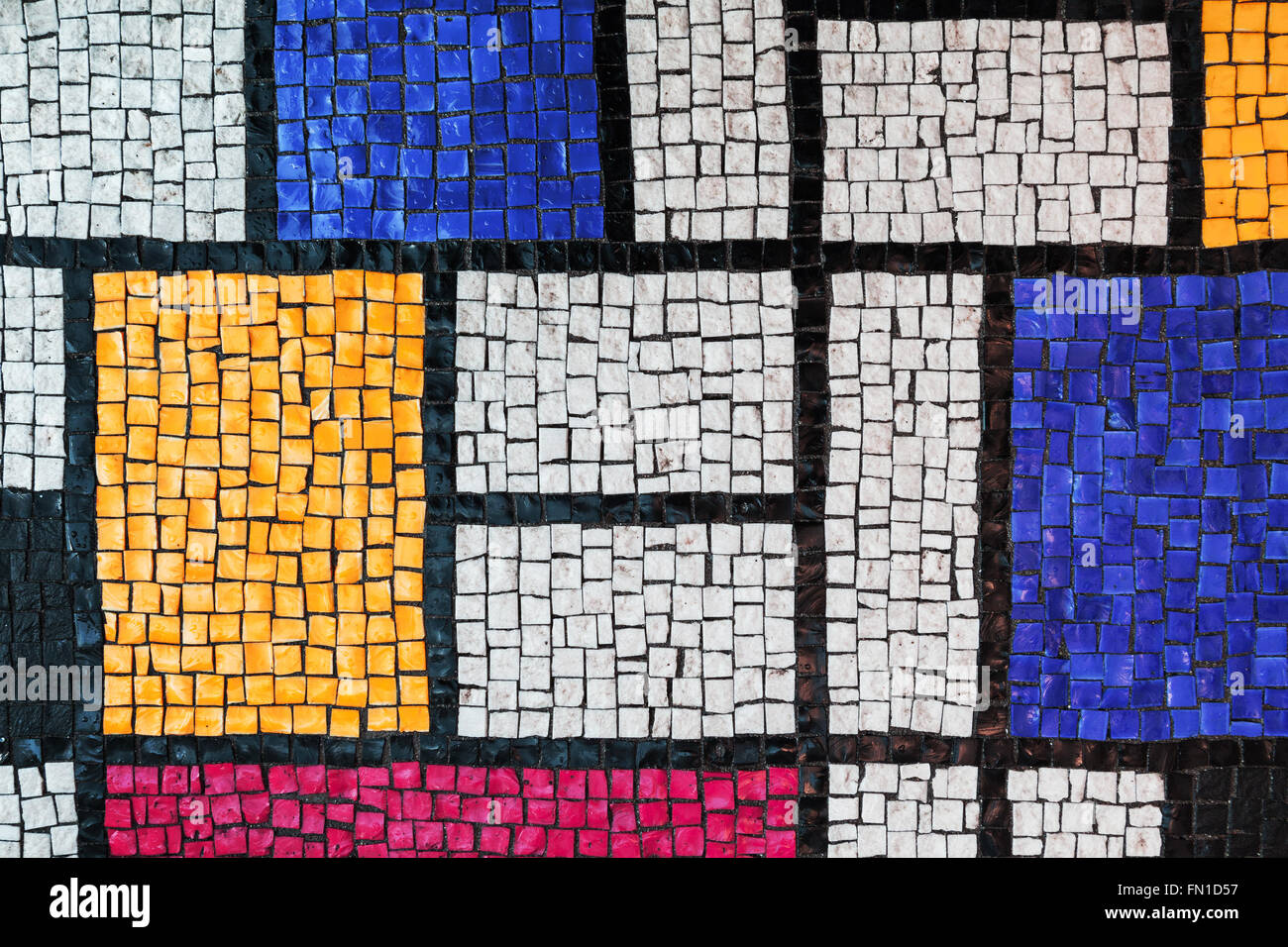 Stone tiling mosaic, made of small colorful square glass fragments. Background texture - Stock Image