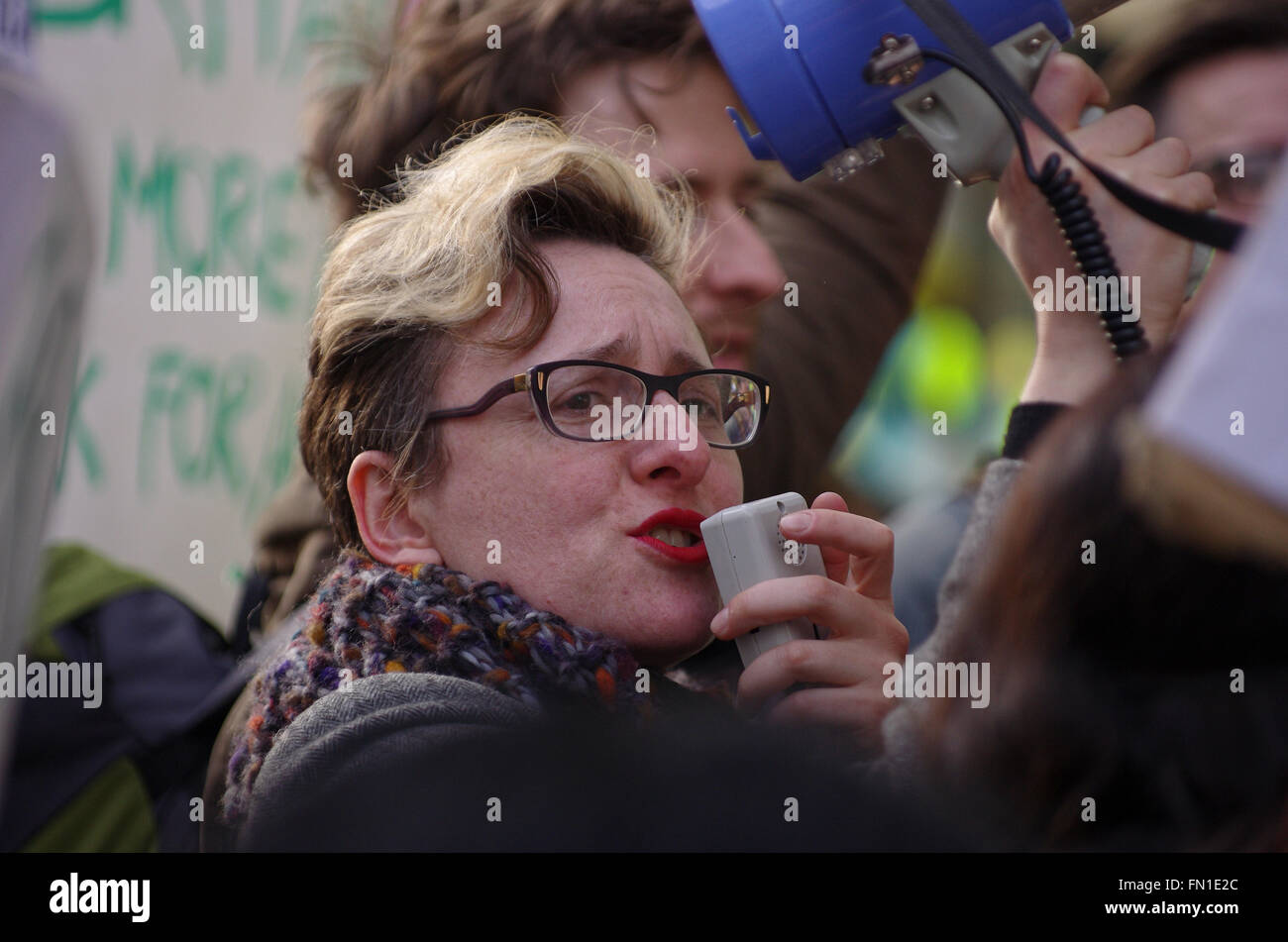 London, UK. 12th March 2016. Cleaners contracted to work at Topshop clothing store protest outside the flagship - Stock Image