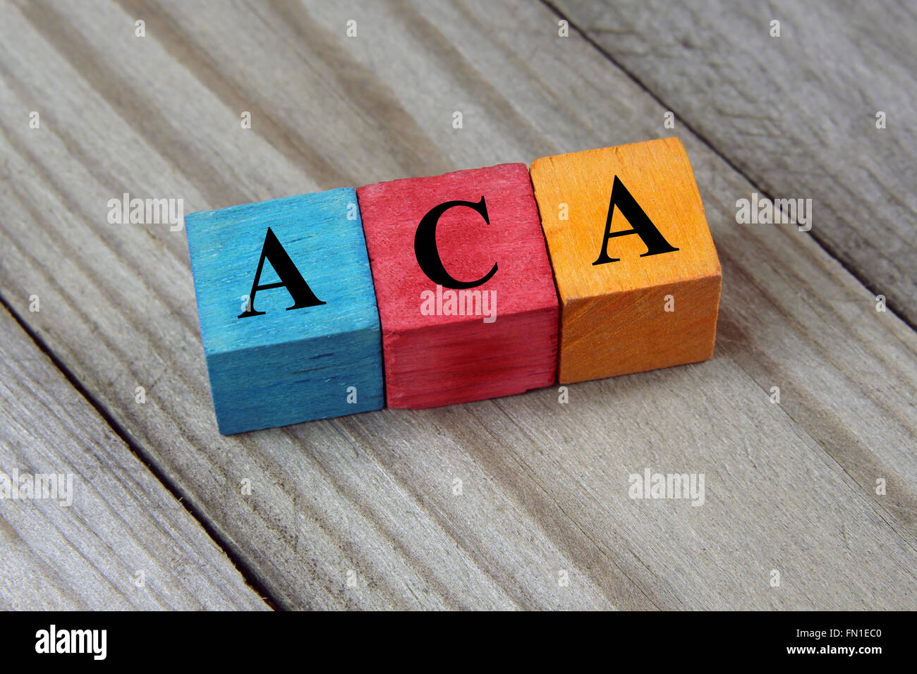 ACA (Affordable Care Act) acronym on colorful wooden cubes - Stock Image