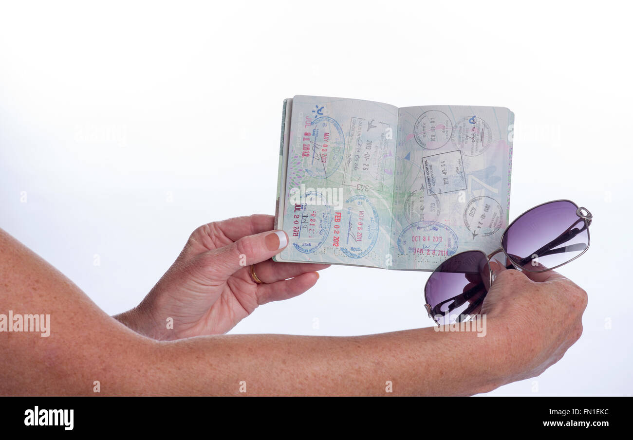 Passport showing immigration entry and departure stamps from various countries Stock Photo