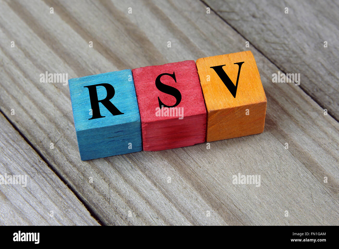 acronym on colorful wooden cubes - Stock Image