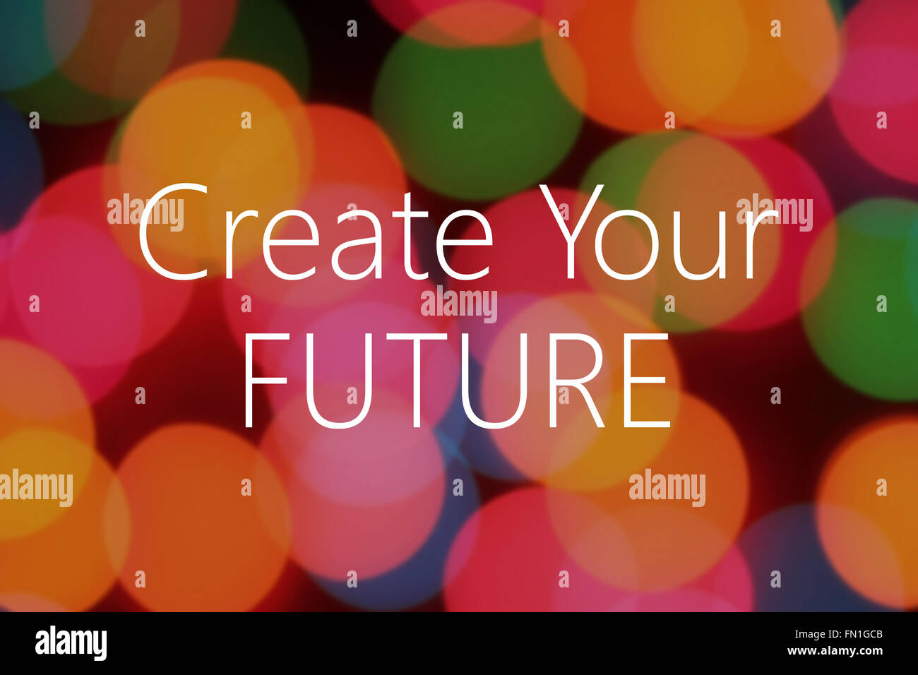 Create your future text on colorful bokeh background - Stock Image