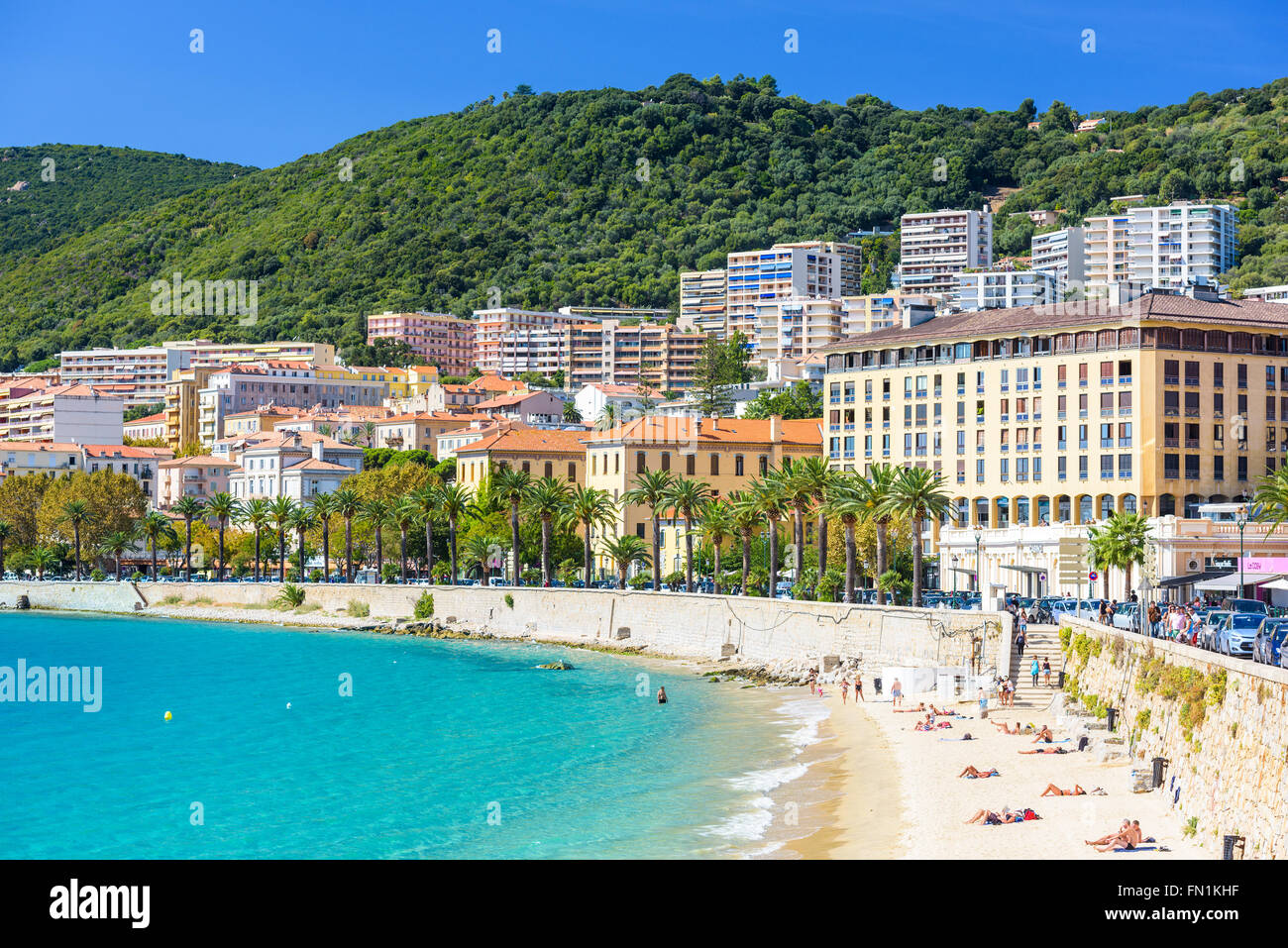 AJACCIO, FRANCE - OCTOBER 29, 2014: Beachgoers on in the Town of Ajaccio on the west coasat of the Corsica Island. - Stock Image