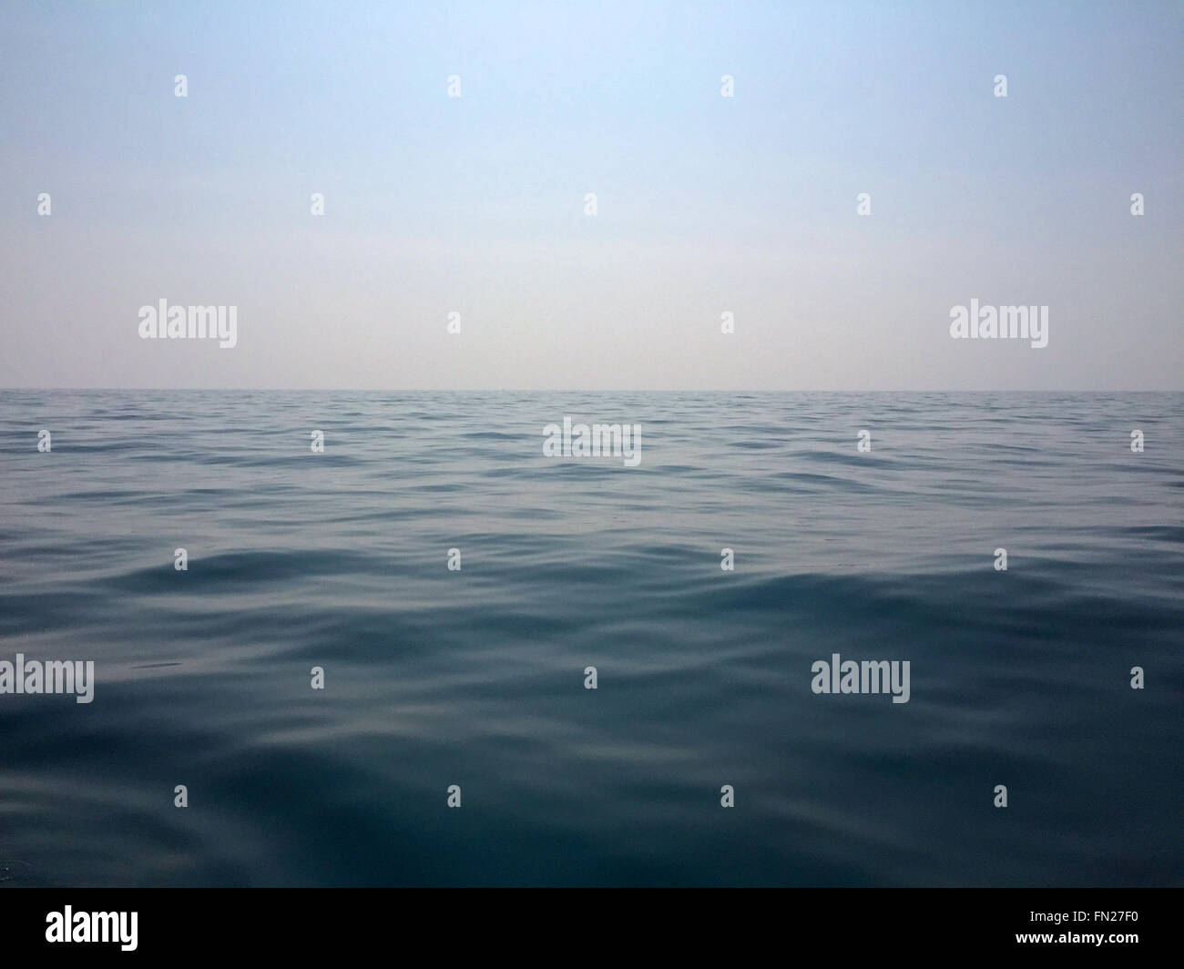A serene view of the sea and horizon. Calm surface. - Stock Image