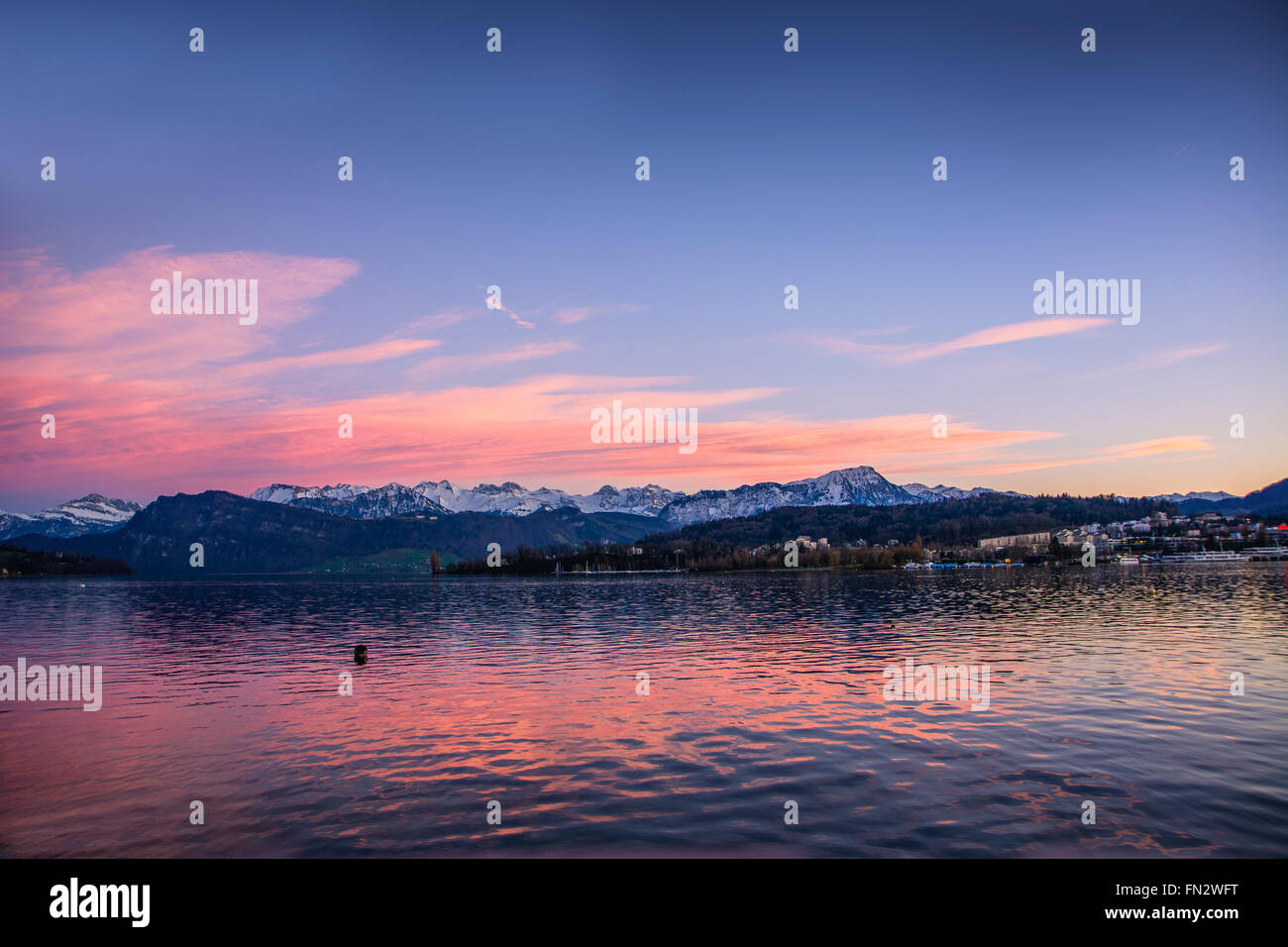 Fascinating view of Lucerne Lake in Switzerland at dusk or sundown - Stock Image