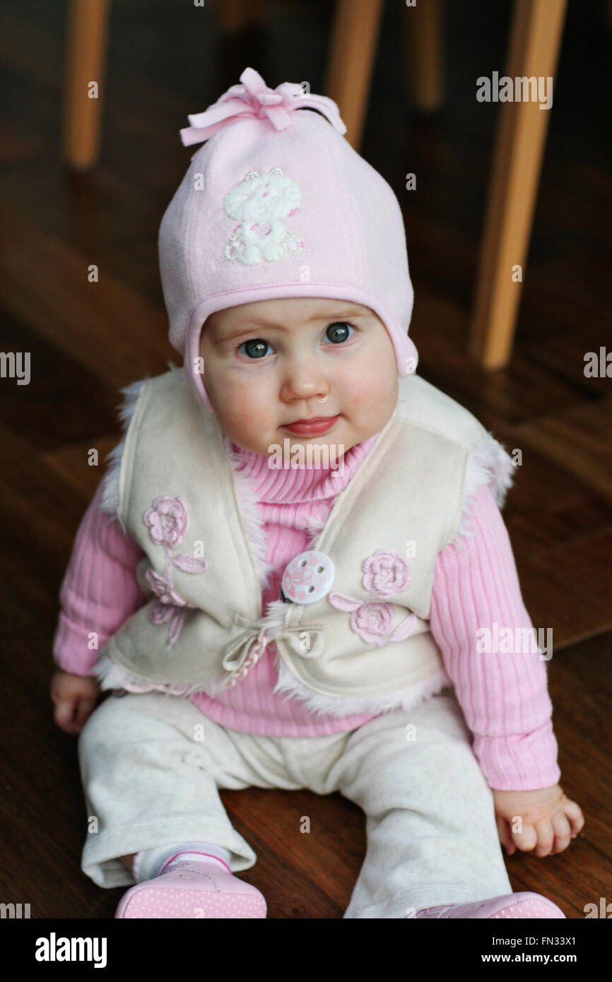 beautiful baby girl, little girl sitting up 9 months old wearing a