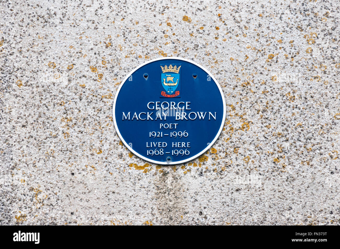 A plaque in Stromness, commemorates the poet George Mackay Brown who was born and lived there. - Stock Image