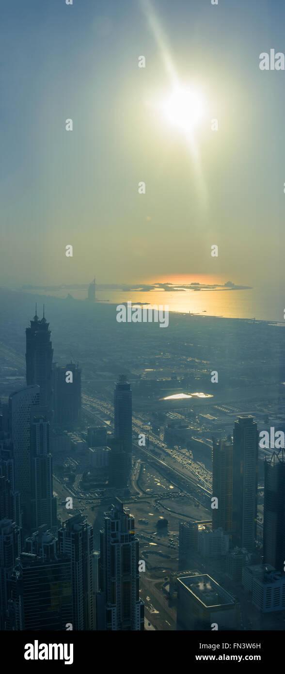 Dubai coastline during sunset, aerial view, lens flare - Stock Image