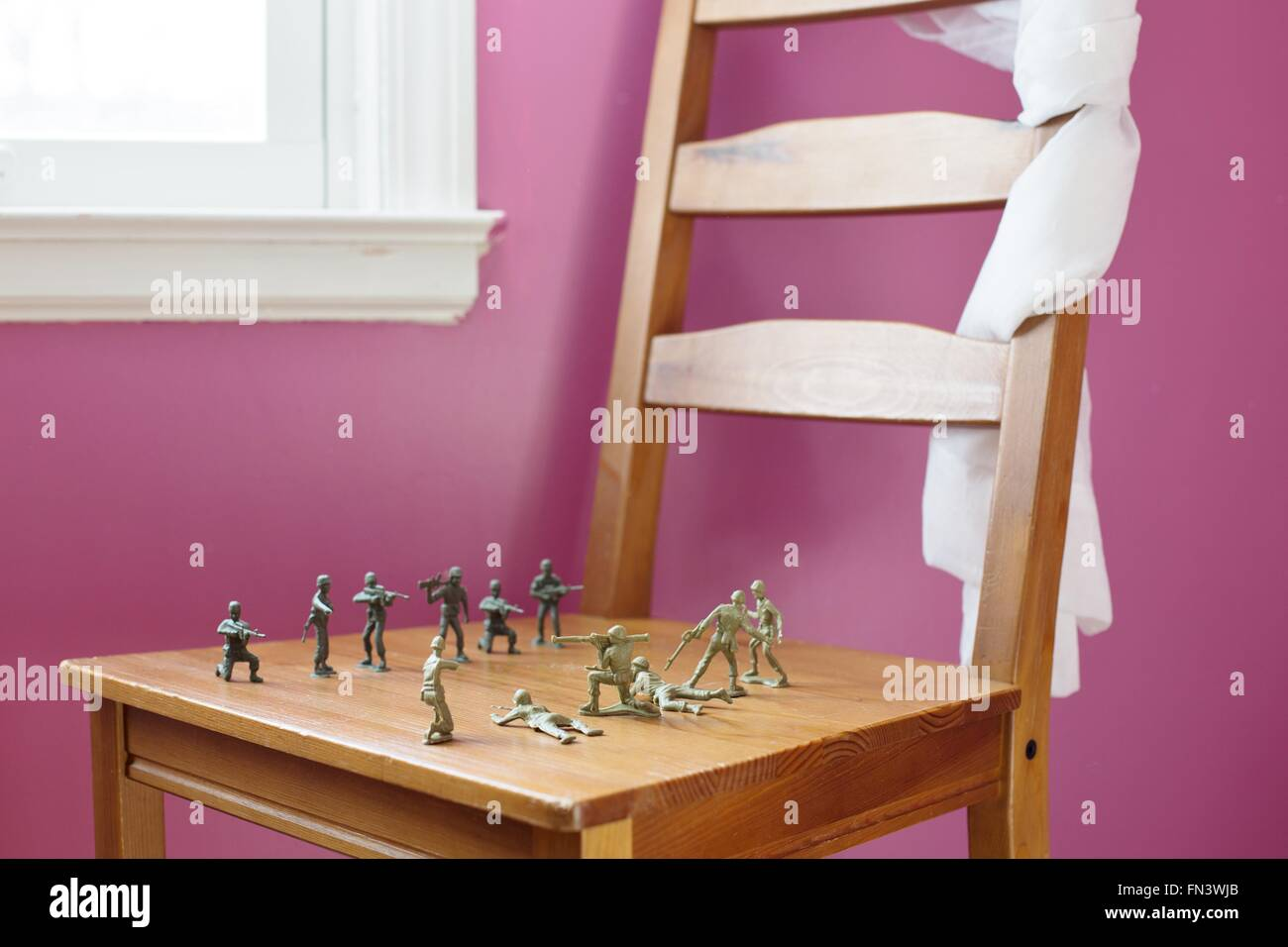 Plastic Toy Soldiers Lined Up For Battle On A Chair In A Pink Girly Stock Photo Alamy