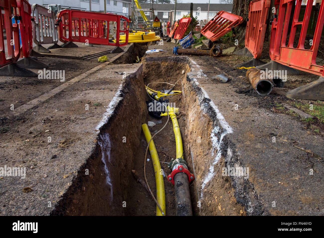 Old metal gas mains pipes being replaced with plastic pipes to prevent gas leaks due to corrosion of the metal pipes - Stock Image