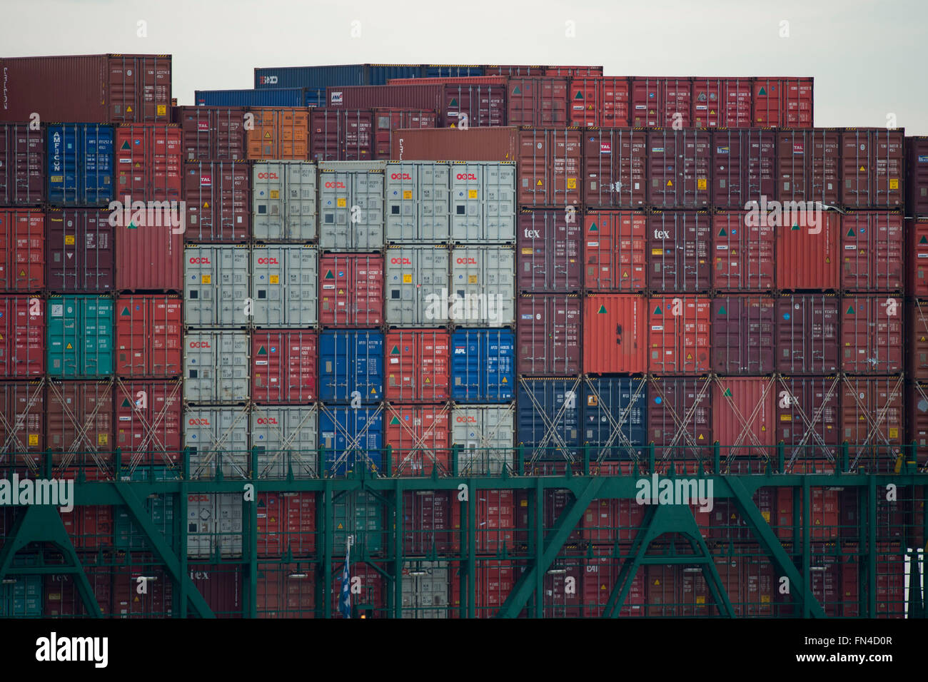 Shipping containers stacked on a cargo ship at Southampton, England, UK. - Stock Image