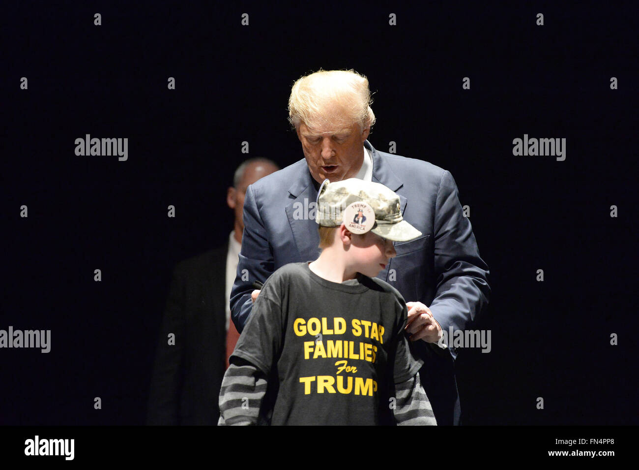Saint Louis, MO, USA – March 11, 2016: Donald Trump signs shirt of boy at the Peabody Opera House in Downtown Saint - Stock Image