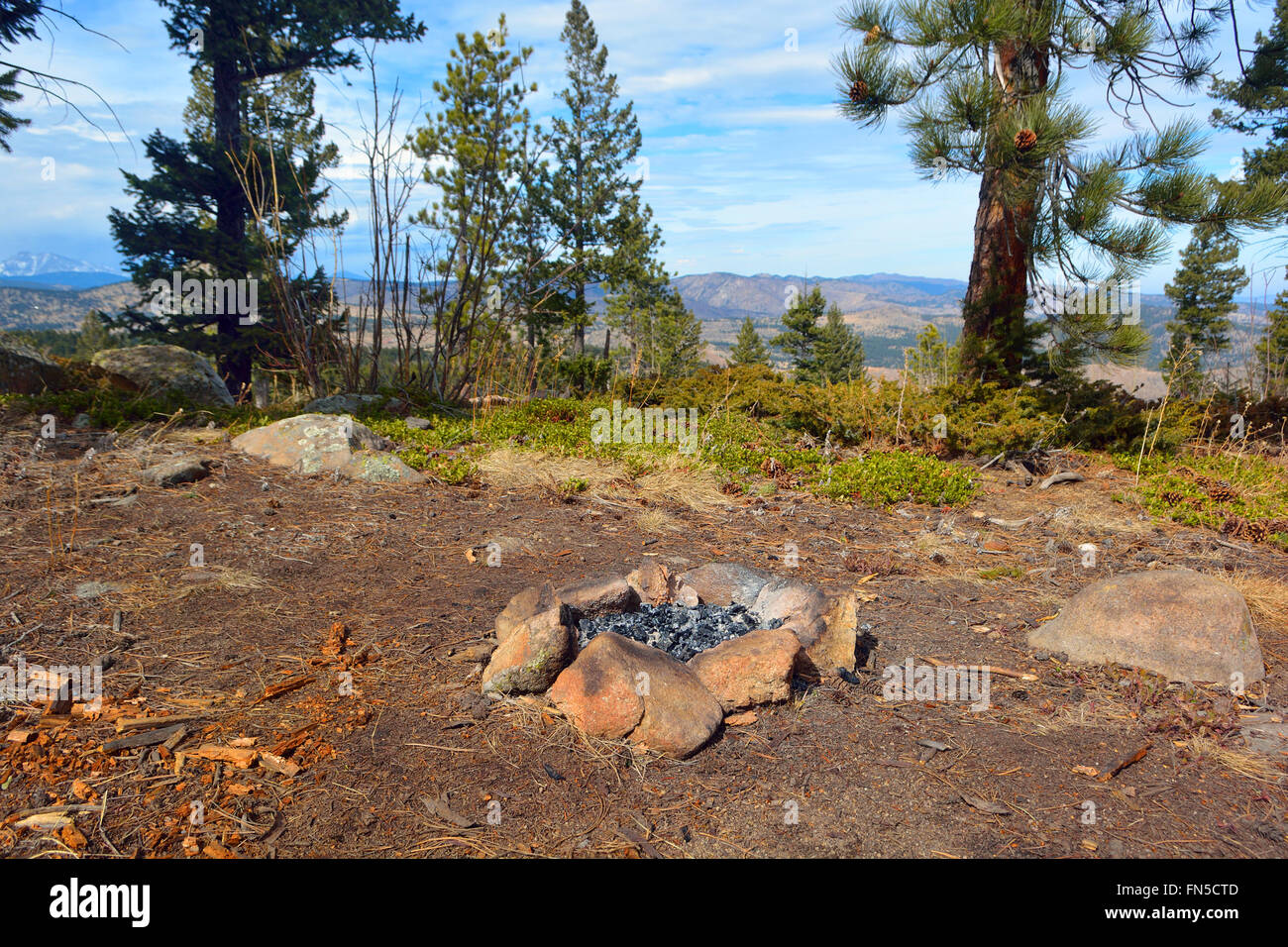 Camp Fire Rock Circle in the Mountains - Stock Image