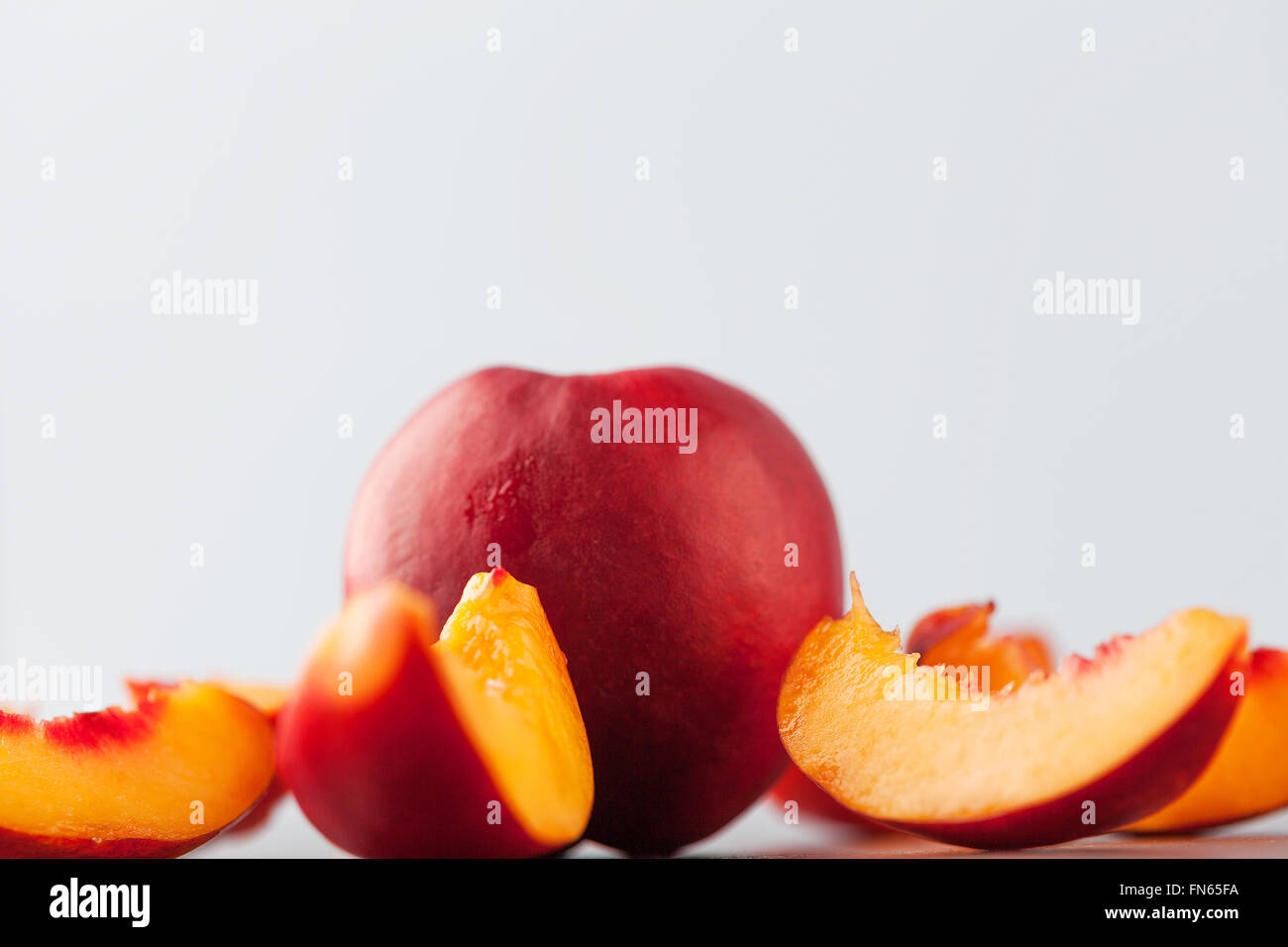 Extreme closeup of yellow nectarine peach slices with copy space. Shallow depth of field. - Stock Image