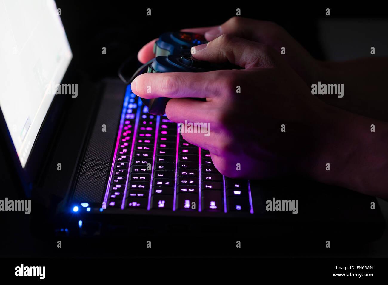 Laptop computer gaming - Stock Image