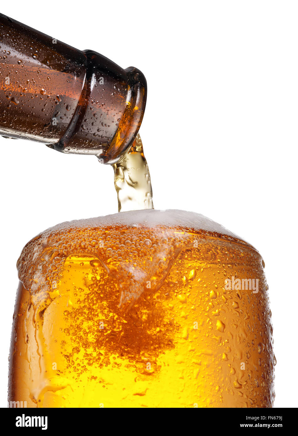 The process of pouring beer into the glass. File contains clipping paths. - Stock Image