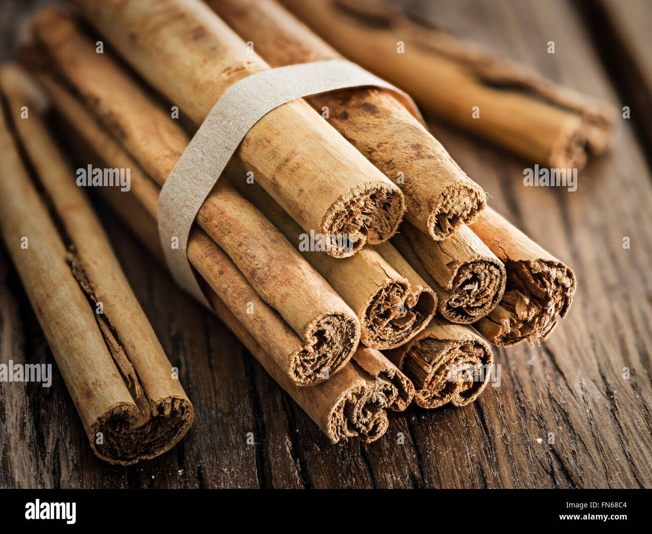 Cinnamon sticks on the wooden table. Close up. Stock Photo