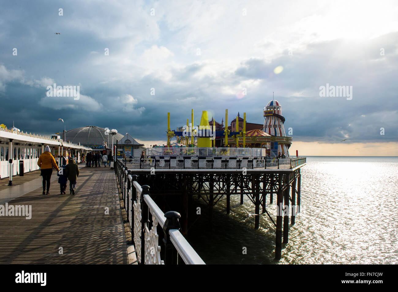 Brighton Pier looking towards the famous funfair and Rollercoaster at the far end. - Stock Image